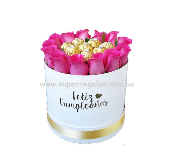 Caja redonda con rosas fucsias y chocolates